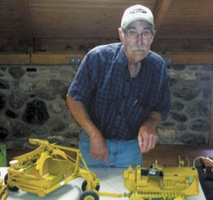 Hobbyist builds miniature construction equipment from scratch