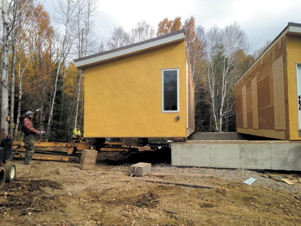 The next straw: builder takes straw bale construction to school