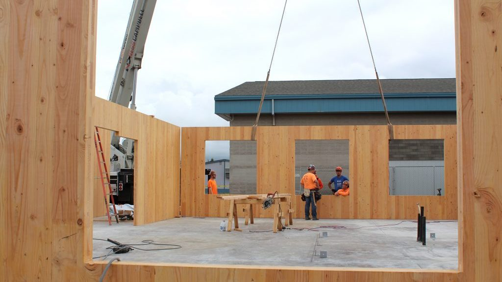 Wood construction pushes forward on both sides of the border