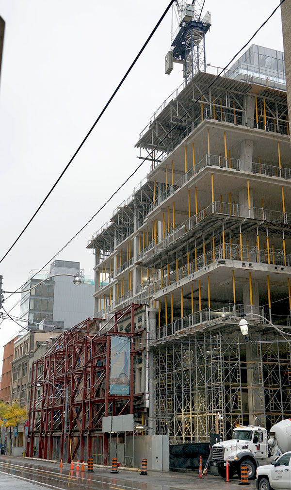 """A concrete cast-in-place 18-storey tower is under construction for Google in Toronto. The climber there does not require a crane when it carries the exterior coating panels for the concrete elevator core. The FCI Self Climbing System by Aluma Systems frees the tower crane for other tasks and also """"frees up real estate"""" on the tight site, explains Joe Plantamura, general superintendent with Structform International Limited."""
