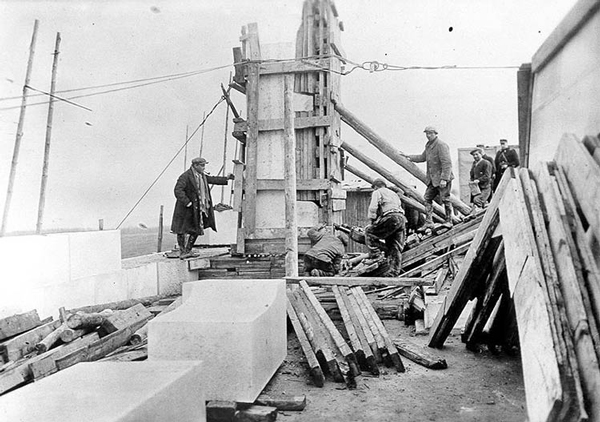 Crews work on the Figure of Canada, one of the many carvings included in the Canadian National Vimy Memorial. The limestone block used for the figure was the largest single block used on the project.