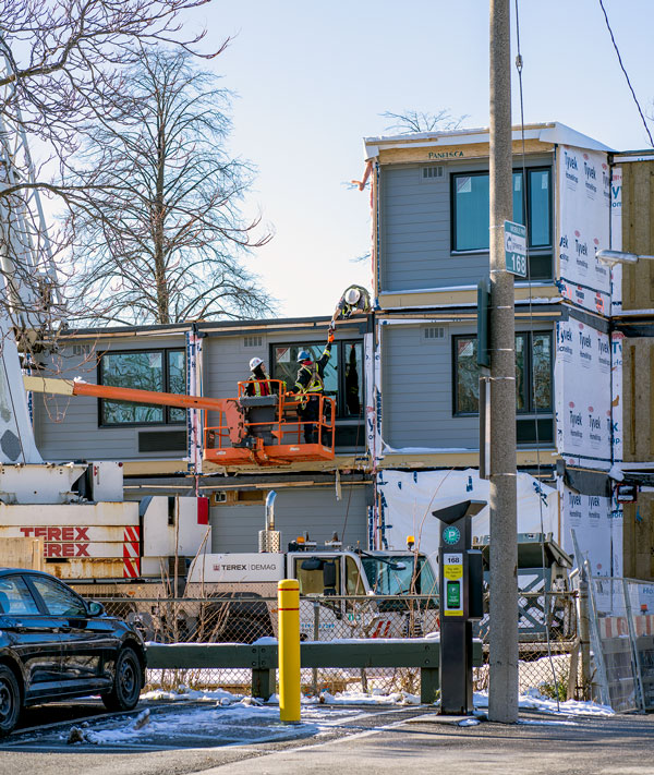 Two City of Toronto affordable housing projects, on Macey Avenue and Harrison Street, will be ready for occupancy in December 2020 and January 2021 respectively. Pictured are workers on the job on Harrison Street.