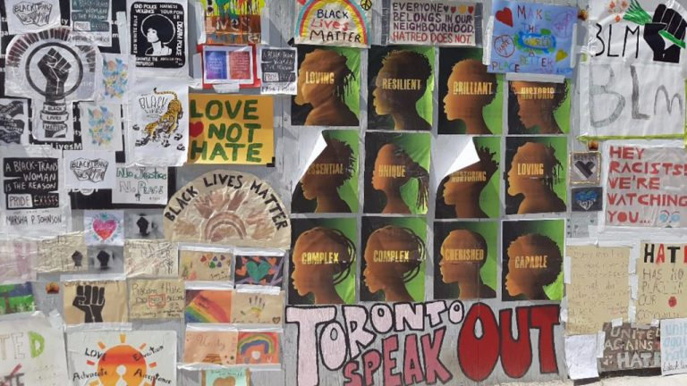 Outside of the Michael Garron Hospital construction site in Toronto, where multiple racially motivated hate crimes occurred, community members pasted posters and art condemning the acts.