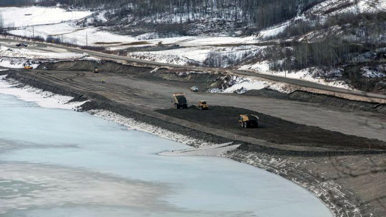 Crews work on the Lynx Creek embankment portion of the Site C Dam project in Fort St. John, B.C. Provincial officials are currently reviewing a recent independent report about the state of dam work.