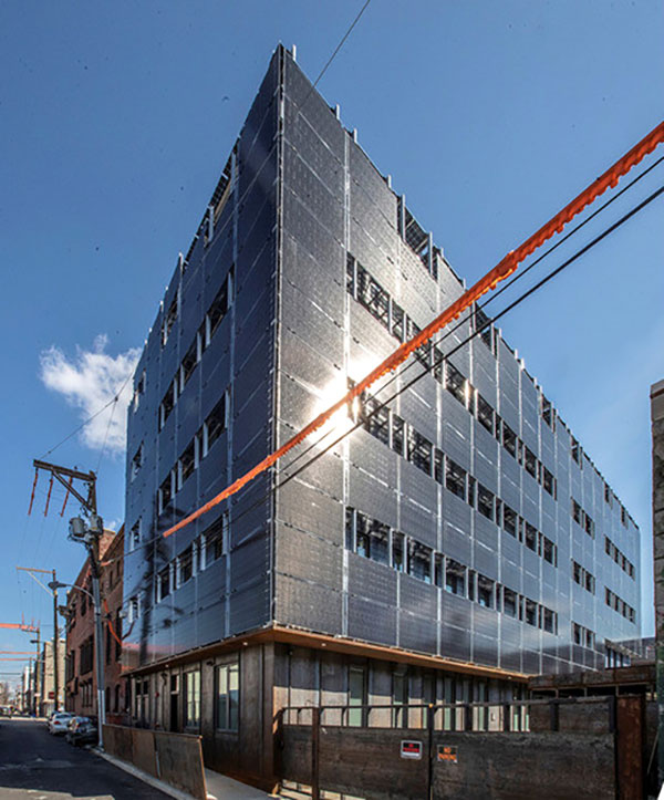 The Front Flats development in downtown Philadelphia, designed by the Onion Flats firm, may provide a glimpse of future multi-storey buildings that aim for true net zero energy status. The four-storey, 28-unit apartment building is wrapped on all sides with 492 translucent solar panels mounted two feet from the building's airtight envelope.