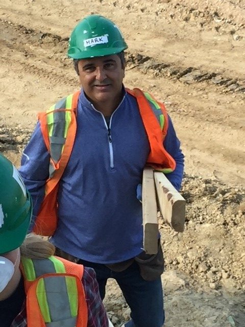 ConstructConnect Canada president Mark Casaletto was on the ground with colleagues numerous times throughout his time with the company, volunteering for Habitat for Humanity.