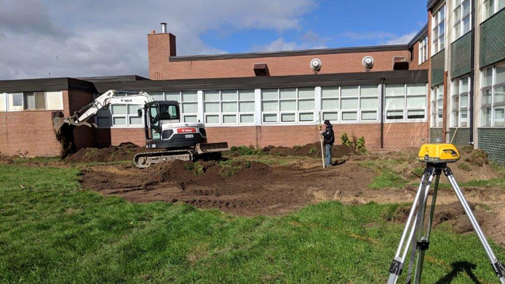 Site excavation work at Allan A. Martin Public School.