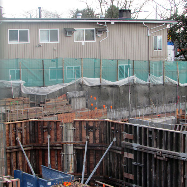 Wet winter weather caused a muddy excavation area and caused some sloughing of shotcrete onsite, but crews were able to stabilize the banks around two excavation areas that flanked an owner's home located in the middle.
