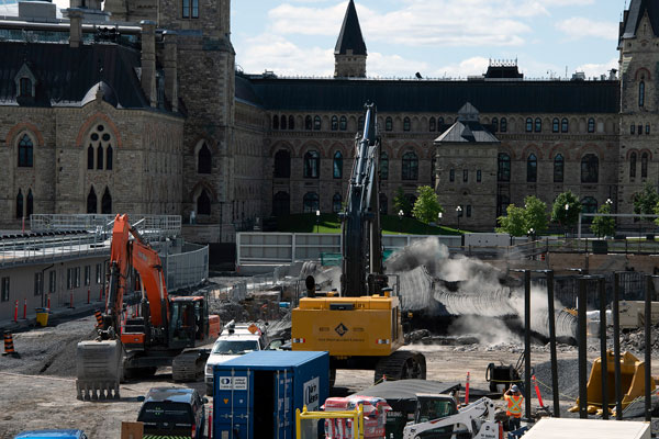 Included in the Centre Block renovation and restoration is the expansion of the underground Parliament Welcome Centre to provide a more welcoming experience for visitors. This photo from August 2020 shows a controlled blast in the area near the West Block in support of excavation activities.