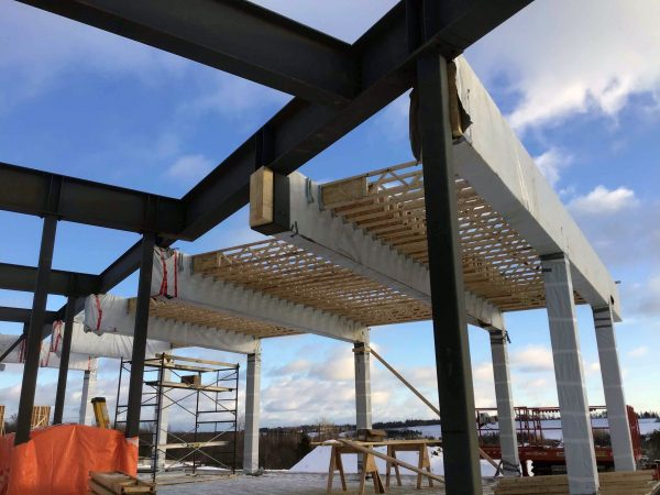 Clad in wood with some steel elements, the University of P.E.I.'s Canadian Centre for Climate Change and Adaptation will feature several energy efficient elements. Large glulam beams and wood frame joists are complemented by steel joists and beams.