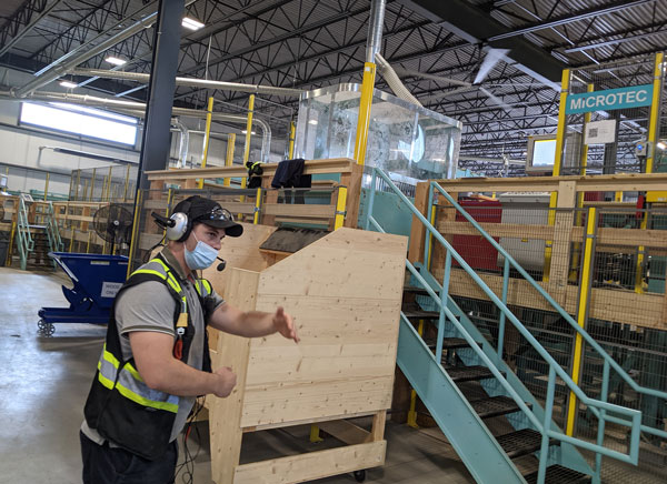 Element5 wood specialist Seth Norris conducted a tour of the firm's new St. Thomas plant Aug. 17.