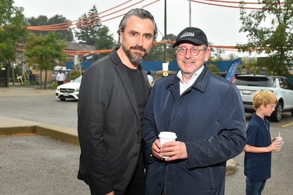 Studio Munge founder and design director Alessandro Munge (left) and Mark Mandelbaum, chairman of Lanterra Developments, celebrated the construction launch of Glenhill Condominiums in Toronto Oct. 3.
