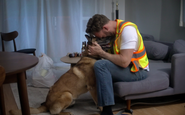 After work the lead character Dave in the Lone Hunter video returns to a darkened apartment and eats takeout in front of the TV, his only companion his faithful dog Marley.